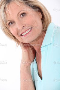 mature blonde depositphotos mature blonde woman wearing turquoise polo shirt having large smile stock photo