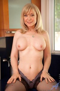 mature blonde picpost thmbs lusty mature blonde topless kitchen pics