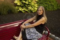 mature feet fmcginn mature senior asian woman seated red metal bench feet take break photo