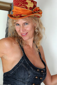 mature gilf photo large sabrina mature orange hat skirt strip free gilf pics