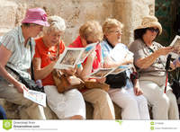 mature group group mature female tourists sitting outside church holy sepulchre holding brochures stock photography