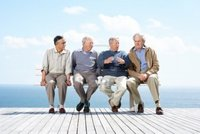 mature group logos portrait group male mature friends sitting together bench ocean outdoor photo