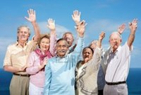 mature group logos portrait group mature friends standing raised hands against sky outdoor photo