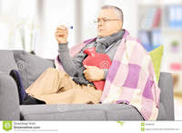 mature hot sick man sofa hot water bottle looking thermomete mature thermometer home stock photography