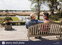 mature huge comp mature couple huge wooden deck luxury showcase house usa stock photo