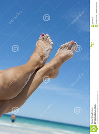 mature legs female legs tropical beach stock photos
