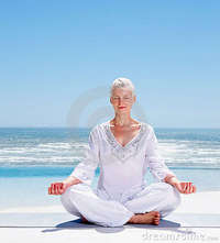 mature old relaxed mature old woman meditating beach royalty free stock photos