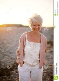 mature old happy mature woman walking beach portrait beautiful old caucasian lady smile face outdoors royalty free stock photos