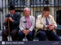 mature old comp ggm portuguese people person old mature elderly men sitting bench near stock photo