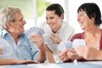 mature old logos smiling mature woman old people playing cards home indoor photo