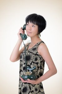 mature old elwynn mature elegant asian woman holding old cellphone closeup portrait studio background photo