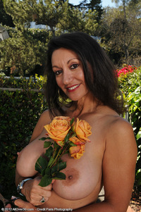 mature persia galleries pics allover persia monir truly beautiful busty lady poses naked among flowers garden
