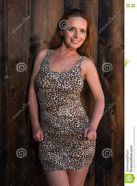 mature red head leopard print dress beautiful tall redhead stock photo