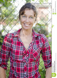 mature red happy smiling mature woman red checked shirt stock photo