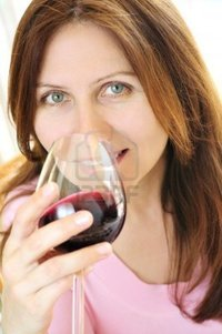 mature red elenathewise smiling mature woman holding glass red wine photo