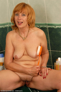 mature redhead redhead toys hairy mature milf tickles clit