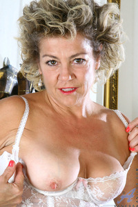 mature tits photo mature woman gets tits out