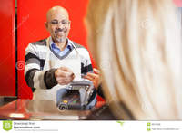mature young mature man accepting credit card young woman men women payment purchases royalty free stock photos