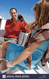 matures comp outdoor day summer water lake boat yacht sailboat sailing woman man stock photo