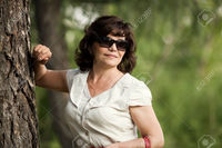 outdoor mature tankist close portrait mature beautiful woman black sun glasses outdoor park summer day stock photo