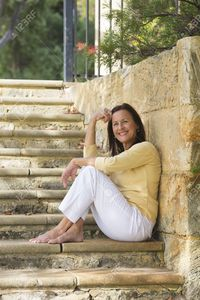 outdoor mature roboriginal portrait confident beautiful mature woman sitting relaxed happy smiling outdoor limestone ste stock photo