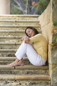 outdoor mature roboriginal portrait beautiful mature woman sitting outdoor wide limestone steps park looking relaxed stock photo