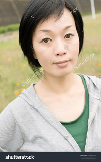 outdoor mature stock photo portrait sport mature asian woman outdoor daytime