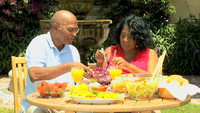 outdoor mature shutterstock videos video clip stock footage mature african american couple eating sensible healthy fresh food outdoors retirement home garden
