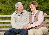 outdoor mature romantic mature couple sitting bench outdoor stock