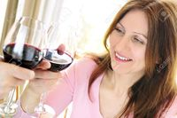 red mature elenathewise mature woman toasting glass red wine stock photo attractive