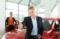 red mature kzenon mature single man red auto light car dealership female customer young woman stock photo