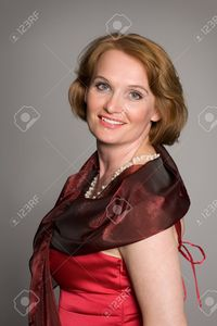 red mature libertos smiling middle aged woman red dress stock photo mature beautiful