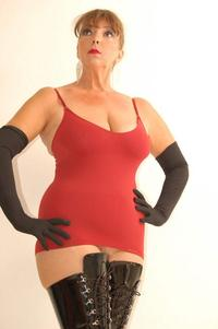 red mature bondage porn mature dominatrix red outfit black pvc boots photo