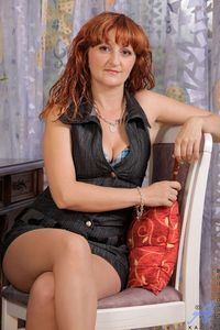 red mature picpost thmbs sexy teasing red hair mature lady sitting chair pics