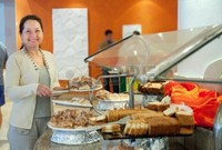 sweet mature jackf mature woman chooses sweet pastry buffet hotel photo