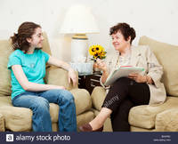 teen and mature comp teen girl being interviewed mature woman could college stock photo