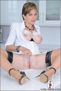 tits heels mature lady sonia high heeled mature shows off perfect tits shaved pussy covered flour