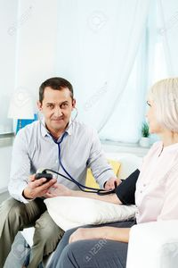 wife mature pressmaster portrait mature man measuring blood pressure his wife looking camera stock photo